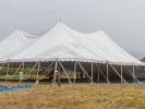 The tent was raised on June 26. It was only half up in this shot.