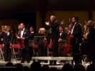 Maestro Allan Pollack and the Festival Orchestra stand to acknowledge applause during the opening concert.