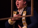 The Officer (James Russell) remains frozen in shock for several minutes as the opera continues around him