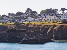 Panoramic view of Mendocino across Mendocino Bay. The music festival's big top tent has been a landmark every July since 1986.